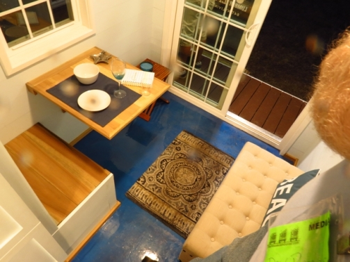 Dining and sitting area in a Tiny Home from 84 Lumber.
